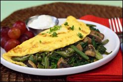 Low Calorie Omelette Recipe 187 Calories  1 cup sliced mushrooms   1/2 tsp. chopped garlic   1 cup frozen French-cut green beans   2 cups chopped spinach leaves   1 wedge The Laughing Cow Light Creamy Swiss cheese   3/4 cup fat-free liquid egg substitute (like Egg Beaters Original)   Optional seasonings: salt and black pepper   Optional toppings: salsa verde, fat-free sour cream