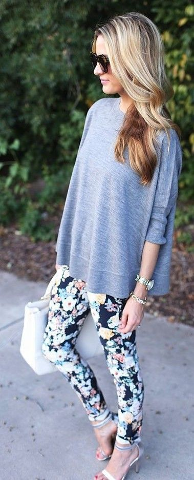 floral pants + grey oversized sweater                                                                             Source