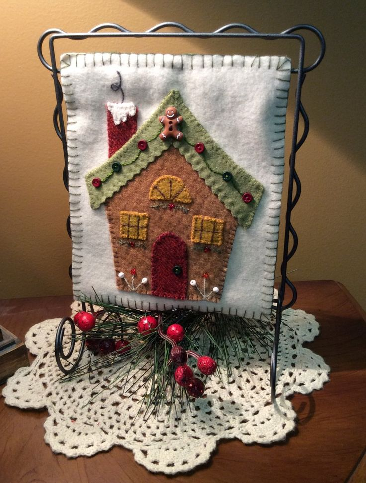 Gingerbread House-This little wool hanging is so adorable!  Kit comes with all the buttons and embellishments!  Patterns are also available!