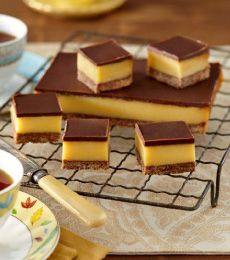 Dark Chocolate Caramel Slices ~ choc & coconut cookie base, cream layer, and choc topping | recipe from Cadbury Kitchen Australia