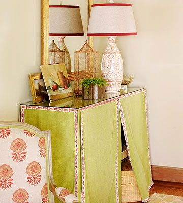 It's Curtains for Clutter!:: If your home lacks an entry closet or foyer, place a small shelving unit against the wall of your living or family room, cover it with a pretty divided skirt and top with piece of glass for easy cleaning. The hidden storage space can conceal shoes, boots, games, and baskets for hats, gloves, and scarves.
