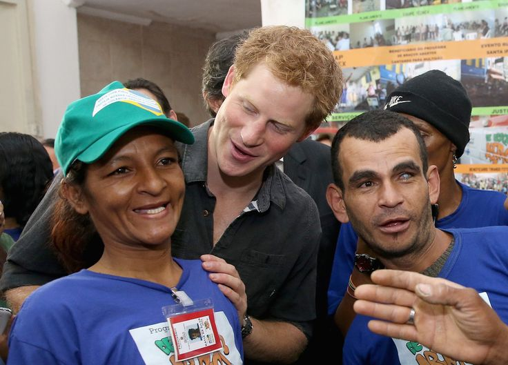 Prince Harry meets crack-addict street cleaners during a visit to 'Cracolandia', an extremely deprived area of Sao Paulo with a high concentration of crack addicts on June 26, 2014