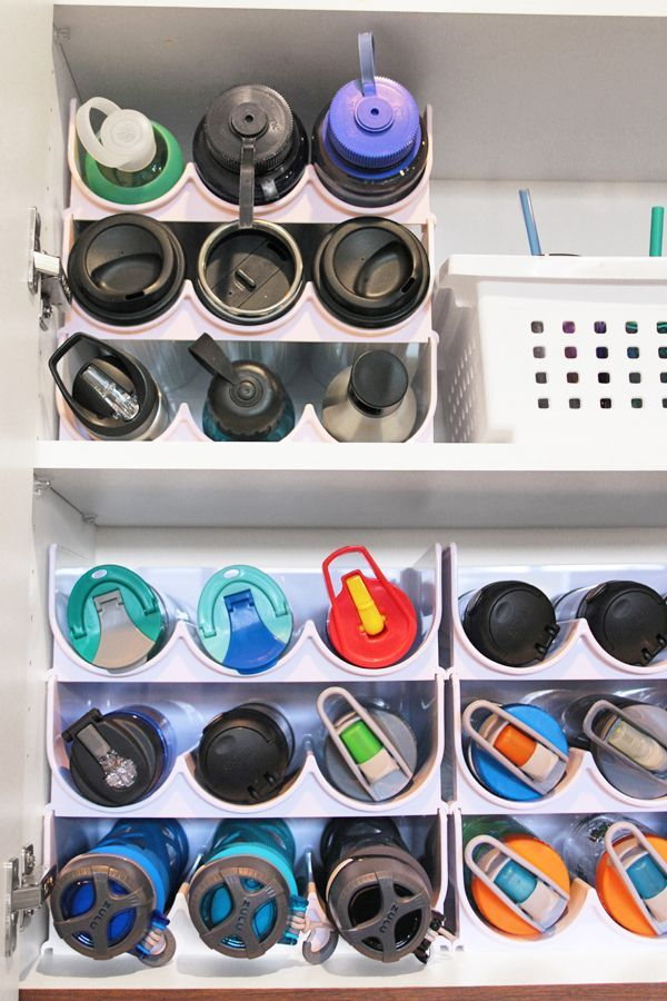 Water Bottle Storage solution! How to organized kitchen cabinets with quick five minute organizing projects. Perfect kitchen cabinet organizers for water bottles, plastic cups, straws, and more. #organizedhouse