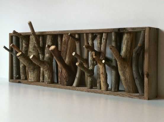 Coat/hat/scarf rack made from branches and a simple wood frame. Love this for a cabin or rustic retreat!