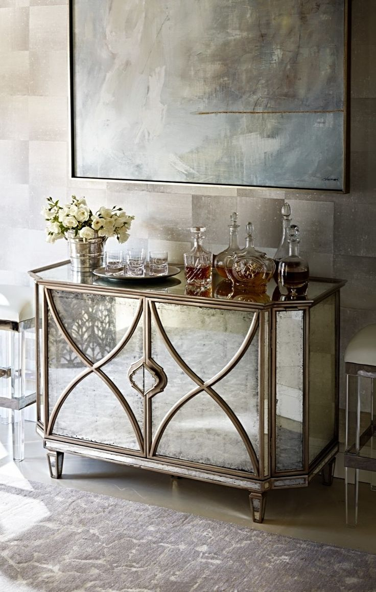 Enjoy the convenience of having chilled beverages and snacks in a master bedroom or guest suite. Our masterfully designed Ainsworth Eglomise Bar Cabinet shines with glamorous style while delivering in-suite access to a compact refrigerator, glassware, spirits and snacks.