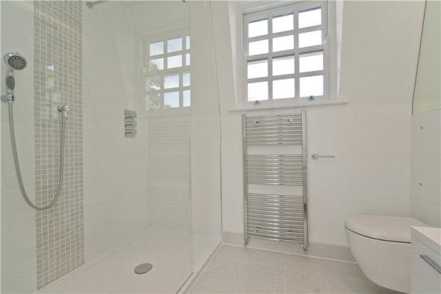 I like these glass enclosed showers