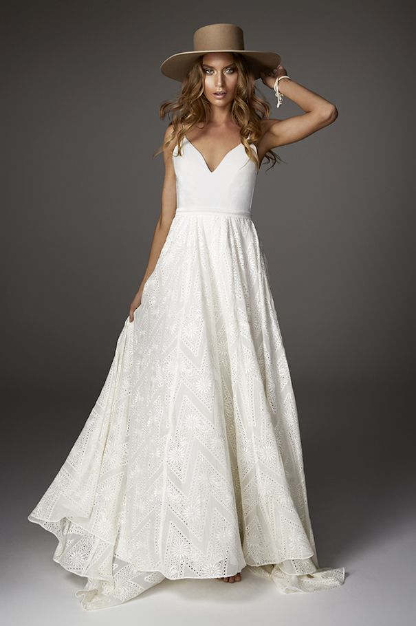 Haze gown from Rue De Seine Love Spell Collection. Understated, elegant and youthful; Haze gown has a low neckline, fitted and boned bodice, with tuck details at front. A gypsy inspired silk embroidered full skirt, and beaded belt at the waist. Low back ties with rouleau straps, and full train. Perfect for the boho bride.
