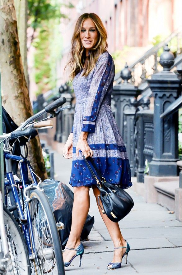 Sarah Jessica Parker in a blue floral patterned long sleeve dress and heels.