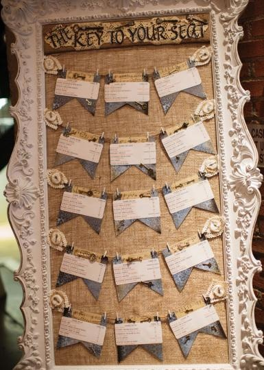 Large homemade vintage table seating chart. Photo by Amy Karp Photography