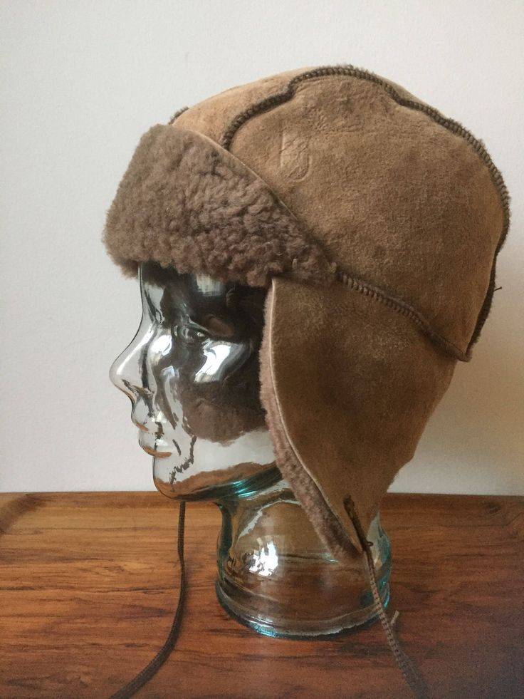 Sheep skin hat/Vintage/brown/wool/1970s/hat/tie strings/details/ear flaps/sheep skin /lamb skin by WifinpoofVintage on Etsy