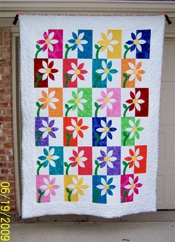 "make with paper and frame like this quilt---extension of positive/negative  and warm/cool lessons.....""Happy Daisies"" by user KathyAire at Quilting Board"
