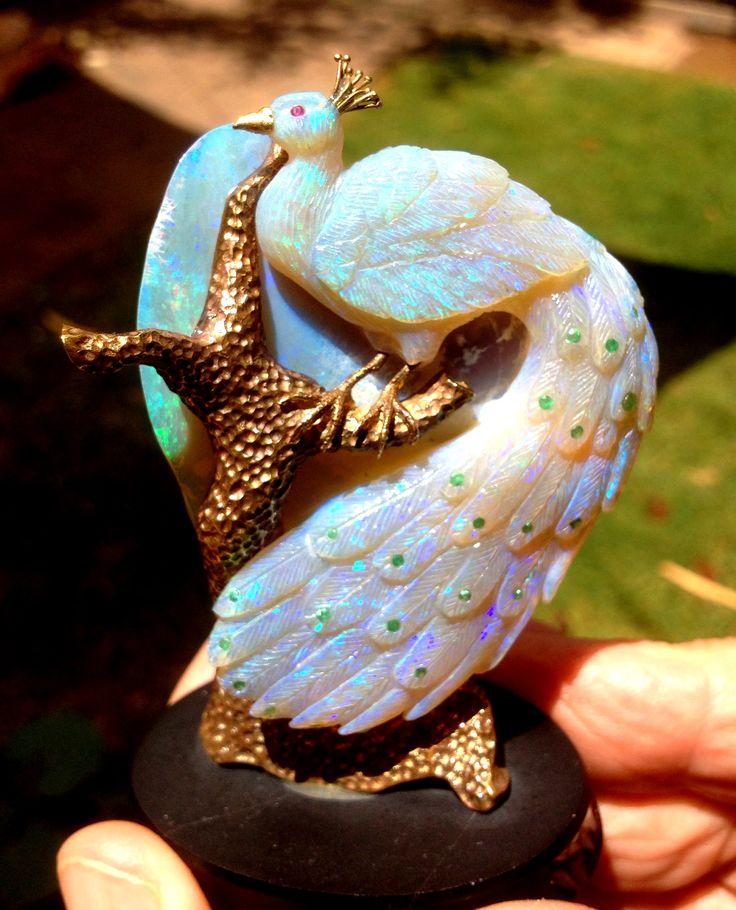 www.sunriseopals.com beautiful..I LOVE opals and I love peacocks