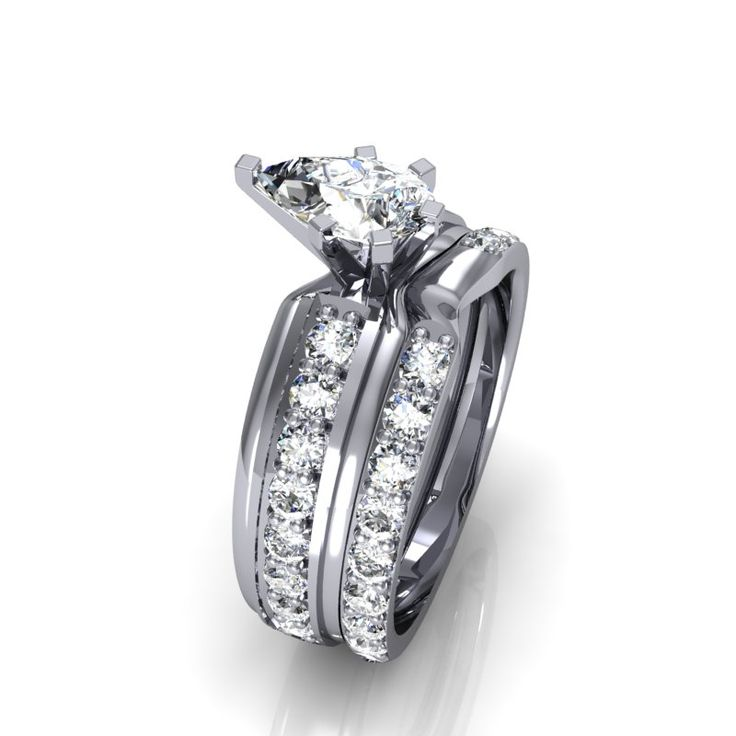 Spectacular Unique teardrop center diamond engagement ring with acpanying diamond shadow wedding band