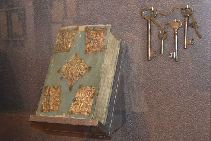 The Gospel, a gift from Nicholas II to his wife, Empress Alexandra Feodorovna on Easter 1916  (Published by the Moscow printing house in 1627). Keys to the Alexander Palace.  Personal items of the Imperial family discovered at the Ipatiev House in 1918  included pillowcases and linens bearing the embroiderd imperial crown