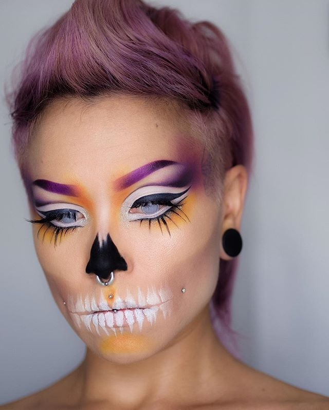 When you can't choose a lipstick, just add teeth. Used a lot of @sugarpill Poison Plum, Buttercupcake, Flamepoint and Tako, and @katvondbeauty Tattoo Liner. Plus @annabellecosmetics Smoothie Eyeshadow Pencil in Licorice topped with @sauceboxcosmetics Black Widow eyeshadow for the blackest nose. . . . #skullmakeup #poisonplum #flamepoint #tako #sauceboxcosmetics #kvdtattooliner