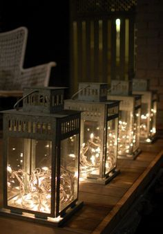 Saw this at a wedding venue. Lanterns with fairy lights inside. Could have them going down the aisle or as centrepiece/ or both. Simple and probably quite cheap to do aswell.
