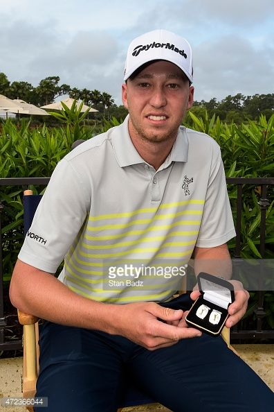 Daniel Berger poses with cufflinks given to him and other first time participants during practice for THE PLAYERS Championship on THE PLAYERS Stadium Course at TPC Sawgrass on May 6, 2015 in Ponte Vedra Beach, Florida.