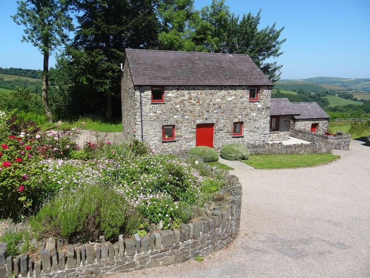 Treberfedd Granary Cottage, Ceredigion. A large open plan living area and sun room offer spectacular views over the Aeron Valley and the hills beyond http://www.organicholidays.co.uk/at/1945.htm