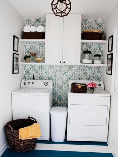 A bold floor and a stenciled wall add a visual kick while a new cabinet makes room for supplies to this once lackluster laundry room. | Photo: Nathan Kirkman | thisoldhouse.com