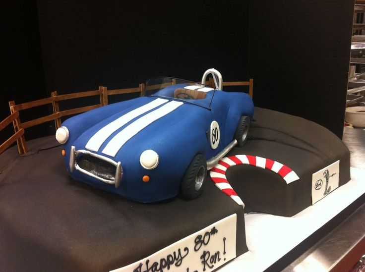 Cobra car cake. Fondant decorated blue car, with white racing stripes ...