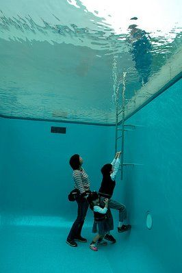 Illusions - Glass ceiling with water on top. Looks like people walking underwater in pool from above.