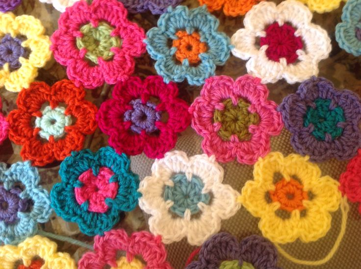 I love flowers and colour  this crochet rug brings them together