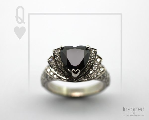 Queen of Hearts, a magnificent ring designed and crafted at The Village Goldsmith. The heart shaped natural black diamond in the centre is surrounded by white diamonds which line the tiered collars.