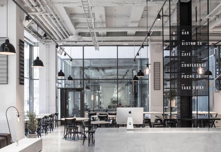 Minimalismo scandinavo e stile industriale per un'ex fabbrica trasformata in locale multifunzionale: bistrot, ristorante, bar e galleria d'arte