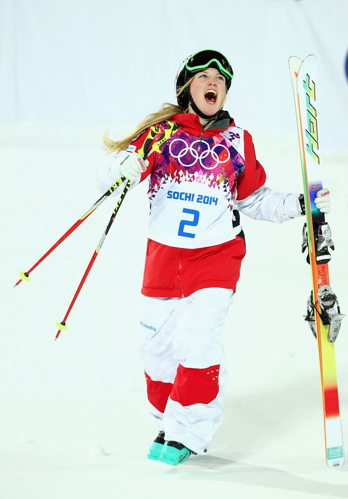 SOCHI, RUSSIA - FEBRUARY 08: Justine Dufour-Lapointe of Canada celebrates after winning the Ladies' Moguls Final during day 1 of the Sochi 2014 Winter Olympics at Rosa Khutor Extreme Park on February 8, 2014 in Sochi, Russia. (Photo by Ryan Pierse/Getty Images)