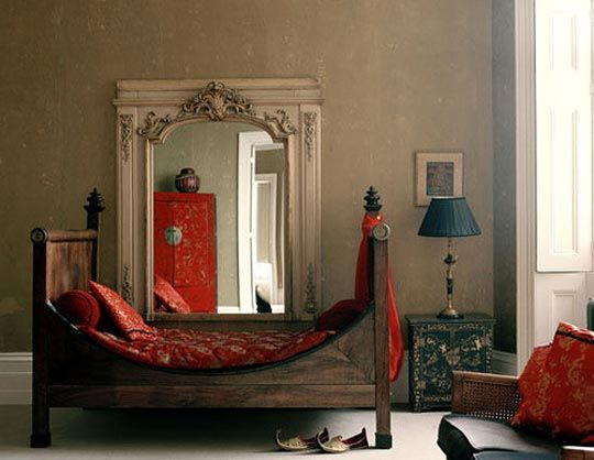 Awesome bed frame. I also love the giant mirror - it makes me wish I had a more Bohemian attitude.