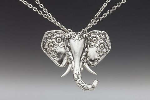 "Elephant Necklace by Silver Spoon Jewelry -- Elephant's ears crafted from 2 spoon handles; face /trunk is a 3rd spoon handle (tusks from fork tines) -  Silver plate pendant: 2"" x 1 3/4"" --  rhodium plate 16-18"" adjustable Chain & Findings --  Made in the USA  $59"