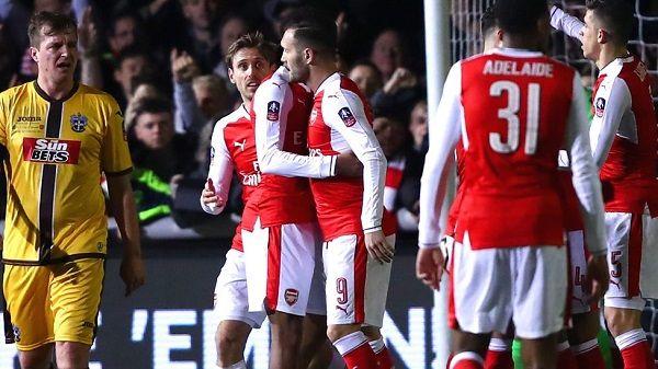 WinNetNews.com - Pada babak kelima Piala FA, Arsenal berhasil mengalahkan tuan rumah Sutton United dengan skor 2-0. Gol-gol Arsenal dicetak oleh Lucas Perez dan Theo Walcott yang memuluskan jalan Arsenal ke perempatfinal.Bertandang ke The Borough Sports Ground, Selasa (21/2/2017) dinihari WIB, Arsenal