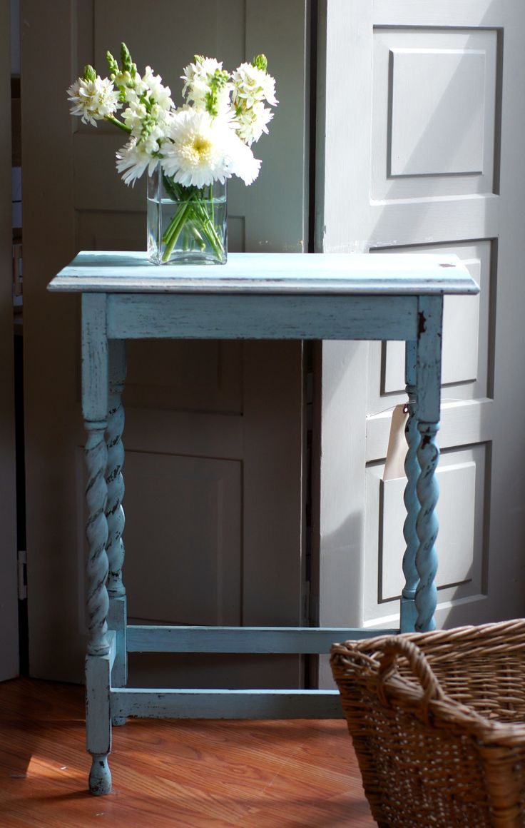 miss mustard seed's eulalie's sky (and a little linen on the edges) of a cute twist-leg table.  furniture wax to protect it.