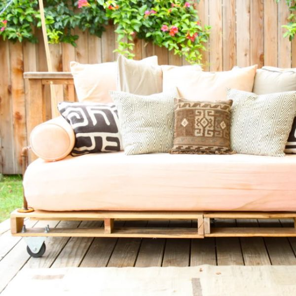 If you're dreaming of the perfect indoor/outdoor piece of furniture that won't set you back on your budget, you'll want in on Prudent Baby's DIY shipping-pallet daybed. Shipping pallets can be assembled on the cheap and have a rustic, industrial vibe that's perfect for the outdoors. You may spot some on the street, but you can also ask a local warehouse if it has any to offer or sell for cheap. While Prudent Baby's version uses a mattress, you can also order a piece of custom-fit foam (try…