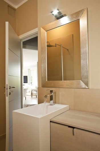 A Contemporary Gold Silver Framed Mirror For A Chic Look In The Bathroom.