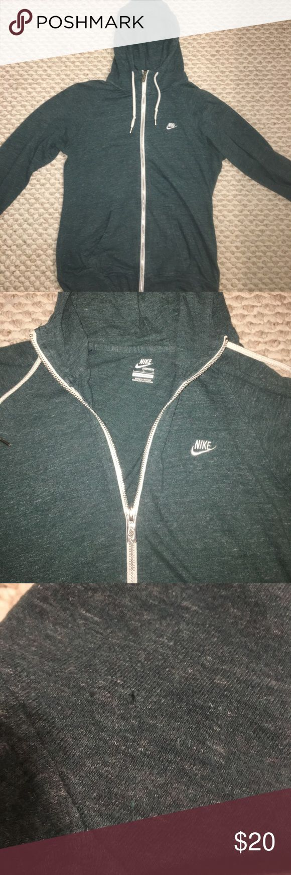 Nike Zip-up Women's green Nike zip-up hoodie. There is a teeny tiny hole in the hood, as shown in the last picture. Other than that, In great condition. Size large. Tops