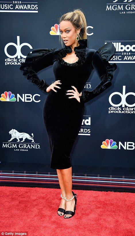 3763bc4114 What a statement  Bebe Rexha (L) donned a velvet high-neck Christian  Siriano gown with a three-dimensional pleated lace detail along her sleeves  and behind ...