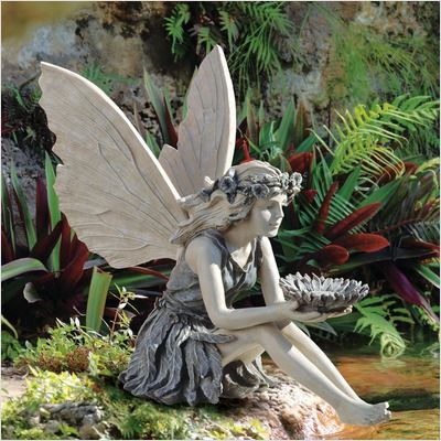 I have this fairy & I love her so much. She sits on a stone that at the base of the top pond where the water spills into the bottom pond. She comes with the sunflower bird feeder & a stainless gazing ball. I have mine holding the gazing ball. Paula