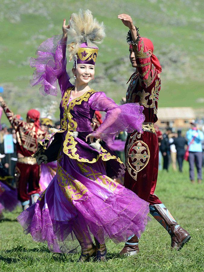 A couple performing a Kazakh dance at the 18th Aqin Aytis Fair in Aletai, Xinjiang