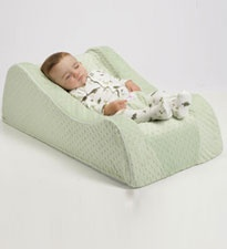 If your baby prefers sleeping in his car seat or swing instead of his crib, the Nap Nanny is your savior. Baby will be so comfortable in the foam-recline bed during naptime, you'll actually have a few moments of silence. $130, BabiesRUs.com