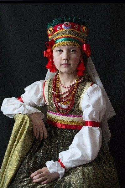 A Russian girl is wearing a traditional costume