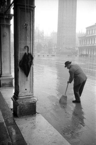 Man sweeping in St. Mark's Square, Venice, 1962 - by Dmitri Kasterine
