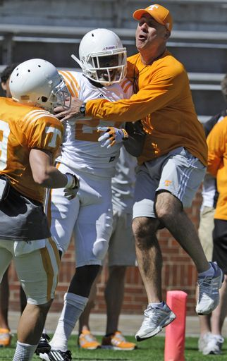 FILE - In this April 4, 2013, file photo, Tennessee secondary coach Willie Martinez, right, congratulates defensive back Justin Coleman during an NCAA college football scrimmage in Knoxville, Tenn.  Martinez worked on Georgia coach Mark Richt's staff before getting fired in 2009, and now will be out to beat his former boss when Tennessee hosts the sixth-ranked Bulldogs. (AP Photo/Knoxville News Sentinel, Amy Smotherman Burgess, File)