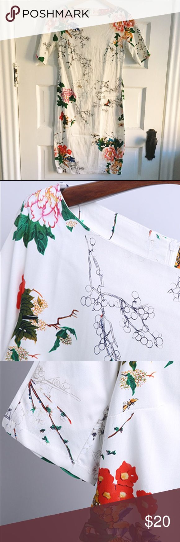 White Floral Cocktail Dress Form-fitting white cocktail dress with flower motif. Really different. Comes down to just above knees with a slit in the back. Hidden zipper and a scoop neckline. Worn twice. Perfect for daytime with a sweater or date night with a pair of bright heels. Dresses Midi