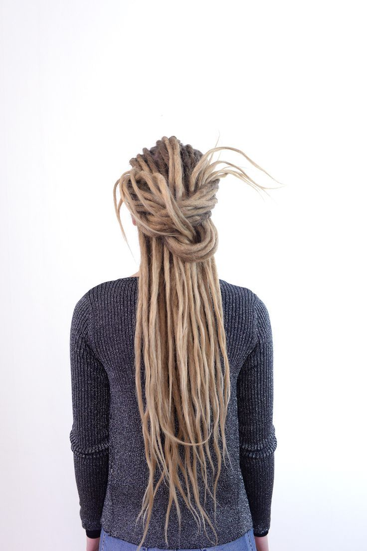 With one simple knot you can achieve this look. Dreadlocks are so much fun this way. #dreadlockhairstyle #dreadknot
