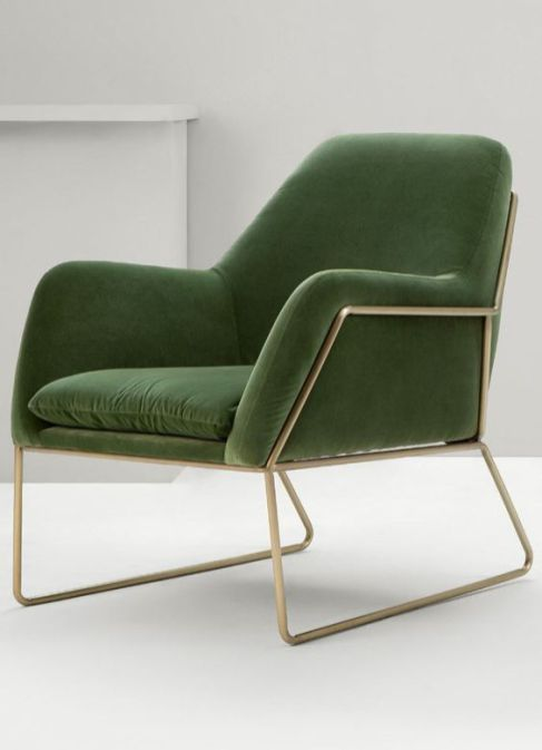 Modern lines in this chair, with a very beautiful leaf green velvet.
