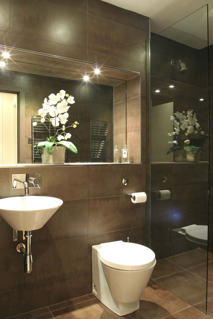 Recessed mirror/ledge edged in stainless steel - contemporary compact cloakroom (powder room)