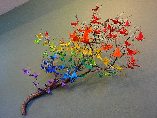 Rainbow Origami Cranes secured to a branch with clear thread. [ETA: I have lost the original pinner whilst looking for the original source. Please let me know if it's you!]