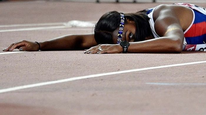 World Athletics Championships 2015: day seven – in pictures | Sport | Great Britain's Tiffany Porter looks up after falling across the finish line in the women's 100m hurdles final. She was leading and looking good at the halfway point, but had to settle for fifth