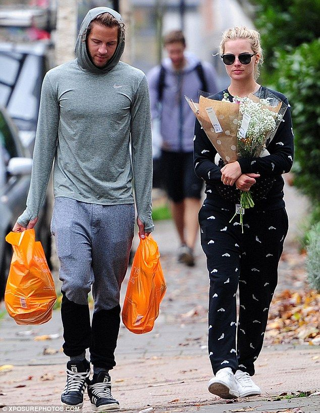 Couple's dressing! Margot Robbie and her boyfriend Tom Ackerley stepped out in their tracksuits on Monday to stock up on groceries and flowers near their London home